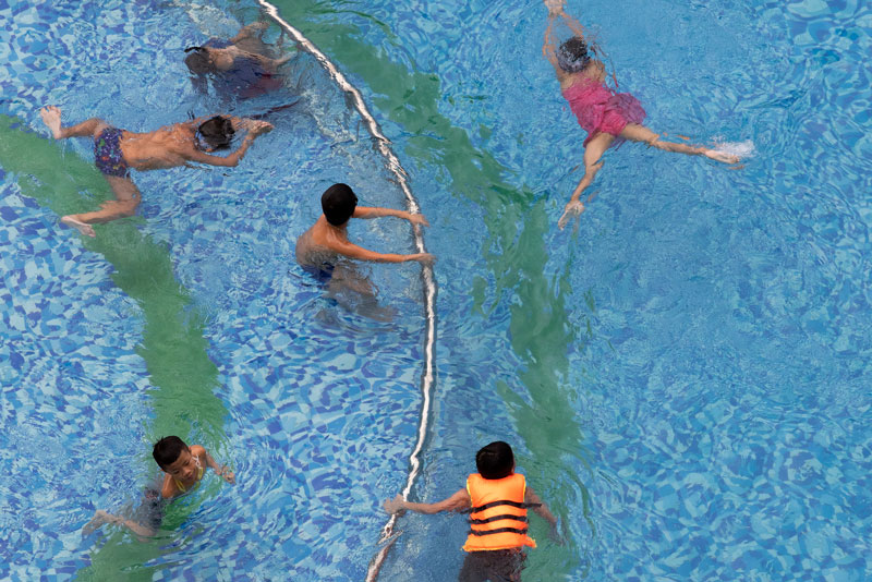 Residents of the EcoHome Phuc Loi apartment building enjoy a Sunday morning swim.