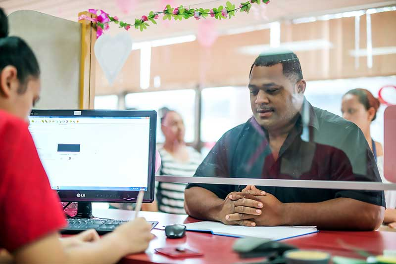 Tongans receive money from relatives working abroad at a branch of the Tonga Development Bank.