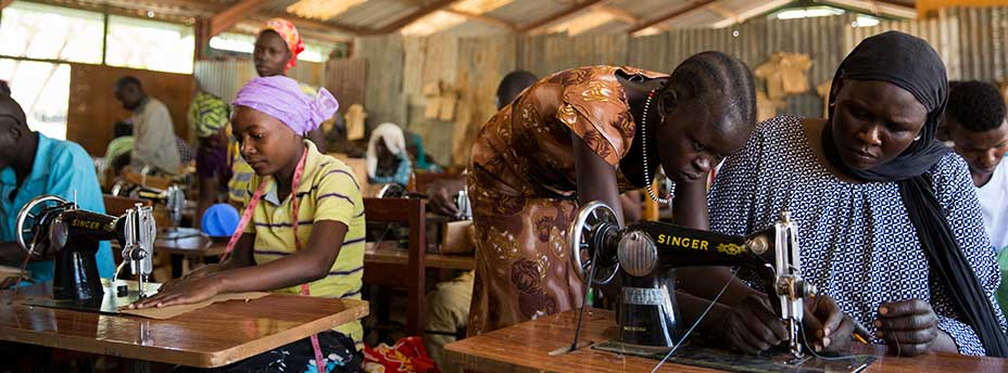 Refugees taking tailoring classes at Don Bosco Technical Institute in Kakuma Refugee Camp. © Dominic Chavez/IFC