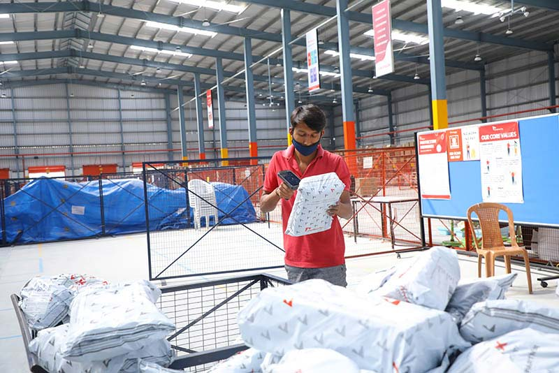 A Shadowfax employee in Bengaluru scans a shipment in the company's delivery center. Photo courtesy: Shadowfax