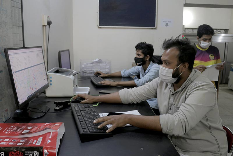 Chaldal staff monitor the company's logistics system at its facility in Dhaka.