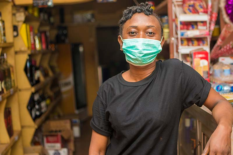 A shop attendant in Africa.
