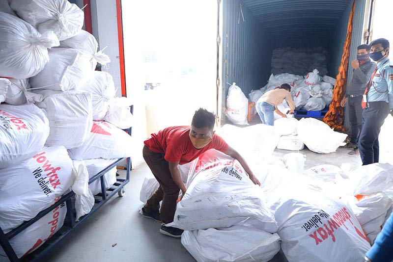 A Shadowfax employee unloads a truck in the Bengaluru delivery center.