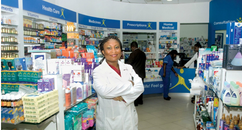 Bukky George at her HealthPlus pharmacy in Nigeria.
