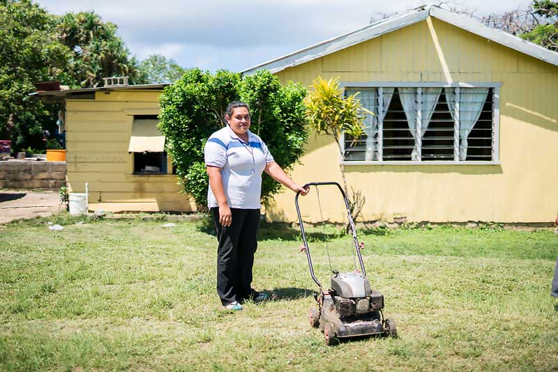 Elizabeth Tau bought a lawn mower and a washing machine with money sent by her husband.