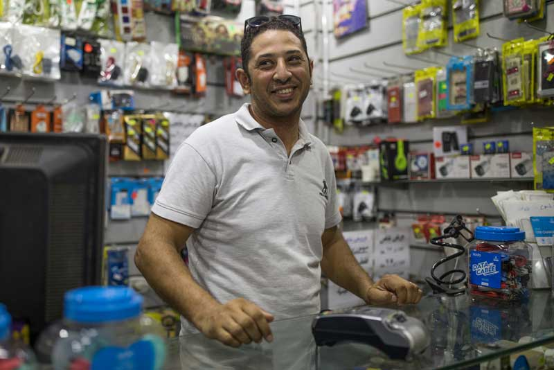 Image: Cairo-based shop owner Nader Shawky can now save time by paying his bills online.