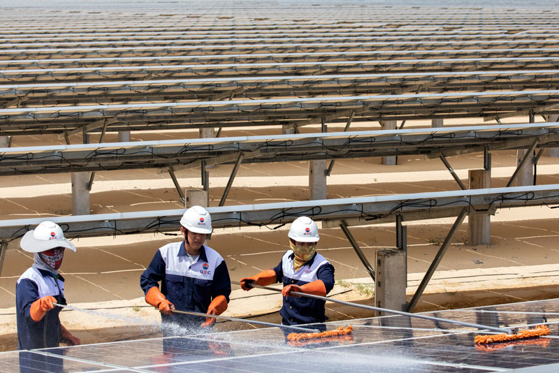 Workers maintain 145,560 solar panels that spread across 45 hectares at the Phong Dien solar plant, in Phong Dien District, Thua Thien-Hue Province, Vietnam.