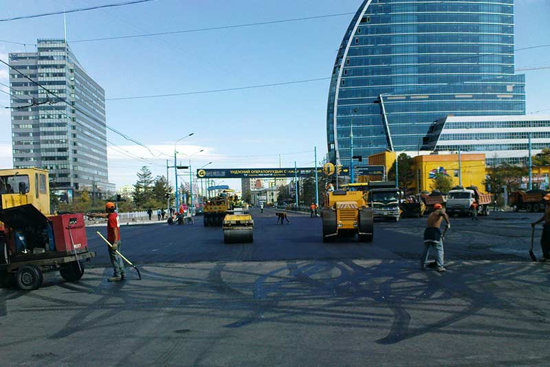 Workers in Mongolia's capital Ulaanbaatar streets. Mongolia.