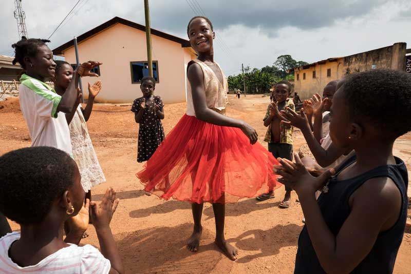 Children dance and play in the village of Essuehyia, Ghana.